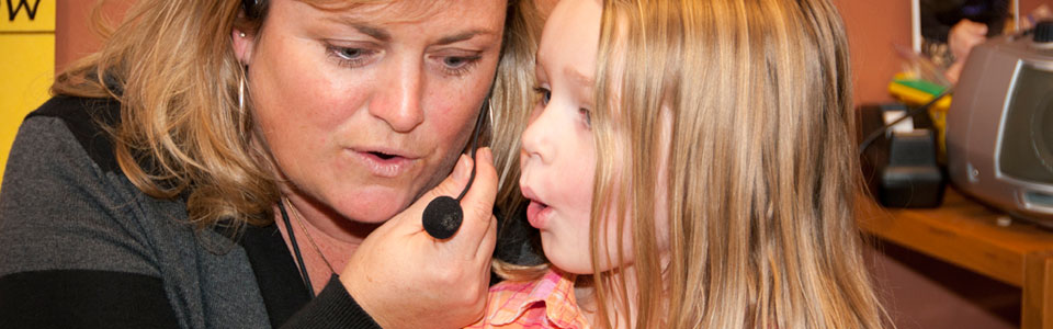 Child speaking into a headset
